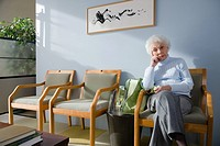 A senior woman waiting in a doctors office (thumbnail)