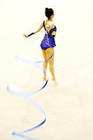 Woman performing rhythmic gymnastics with ribbon