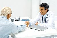 Doctor shaking hands with patient (thumbnail)