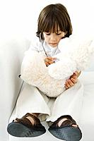 Little boy playing doctor with stuffed toy, using stethoscope