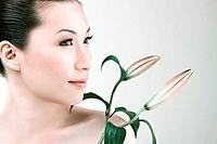 Woman posing with flower buds