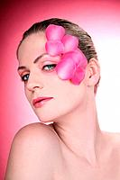 Woman with flower petals decorating her face (thumbnail)