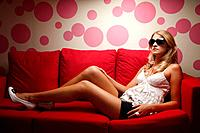 Woman posing for the camera on a sofa (thumbnail)
