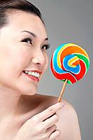 Woman with lollipop looking to the side (thumbnail)