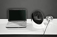 Laptop with fencing mask and foil on the table (thumbnail)