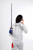 Confused man in fencing suit holding a sword