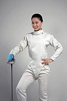 Woman with fencing foil posing for the camera