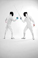 Two men in fencing suits in a duel