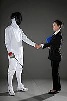 Man shaking hands with a businesswoman