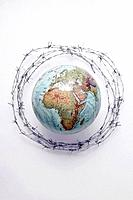 Globe surrounded by barbed wire