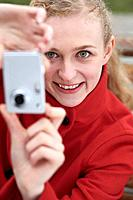 Woman taking picture with her digital camera