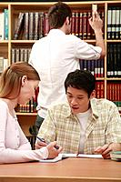 Man and woman having discussion in the library