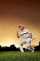 Man cheering in golf course