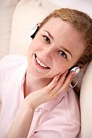 Woman listening to music with her headphones on