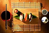 Sushi on chopping board