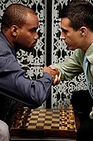 Businessmen playing chess game (thumbnail)