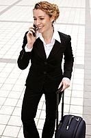 Businesswoman laughing while talking on the phone (thumbnail)