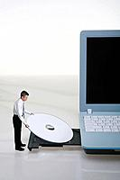 Businessman placing disc into disc drive