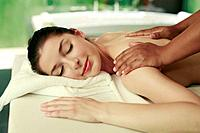 Woman enjoying a back massage (thumbnail)