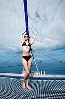 Woman in bikini posing on yacht