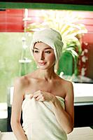 Woman in towel with hair wrapped in towel