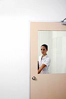 Nurse opening the door