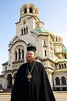 Sofia, orthodoxe pope standing in front of Alexander-Newski-Cathedral, Bulgaria