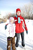 Portrait of 9 and 13-year old girls in skates, The Forks, Winnipeg, Canada
