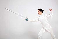 Woman in fencing suit with fencing foil
