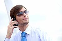 Businessman with sunglasses talking on the phone