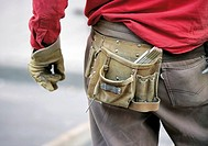 Construction worker wearing tool belt