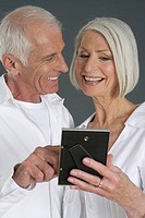 Senior couple looking at a picture