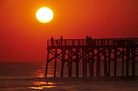 Tourists on the pier at sunrise, Flagler Pier, Flagler County, Florida, USA