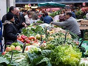 People buying fruits and vegetables in a market, Barcelona, Catalonia, Spain