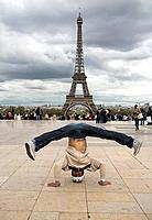 Acrobatic in front of the Eiffel Tower, Paris, France