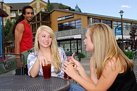 Black male skateboarder making eye contact with two women