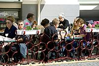People having lunch on a beer garden, Ystad, Skåne, Sweden