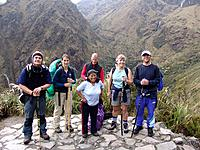 peru a group of people posing near a valley
