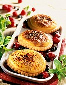 Creme brul&#233;e tartlet with stewed summer fruit