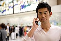 Young man using cellphone