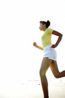 A woman jogging on the seashore