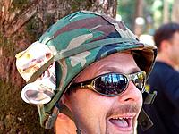 one man looking very crazy mad person wearing a military hat