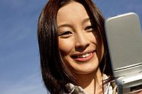 Close-up of a young woman using cellphone