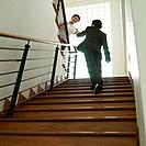 Low angle view of a businessman shaking hands with a businesswoman on a staircase