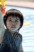 A boy holding a water pistol