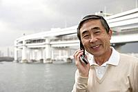 Portrait of a senior man using cellphone