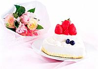 Strawberry cake and bunch of flowers