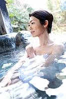 Woman in a hot tub, side view, Japan (thumbnail)