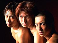 Group of three young adult men staring, Naked, Studio