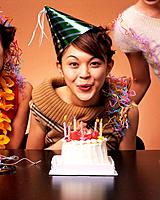 A Young Woman Celebrating Her Birthday Party with Some Friends, Front View, Looking at Camera